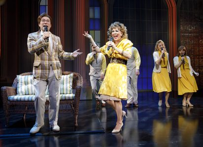 Chaz Pofahl as Jim Bakker and Kirsten Wyatt as Tammy Faye Bakker, with members of the Company, in BORN FOR THIS – A NEW MUSICAL.