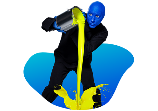 The blue man group: a blue man pouring yellow paint