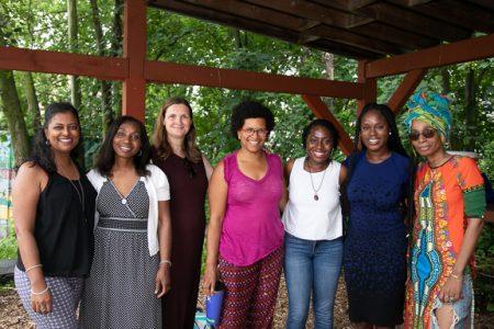 7 women standing under a pavillion