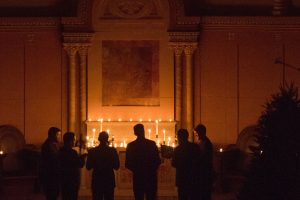 men-chant-by-candlelight